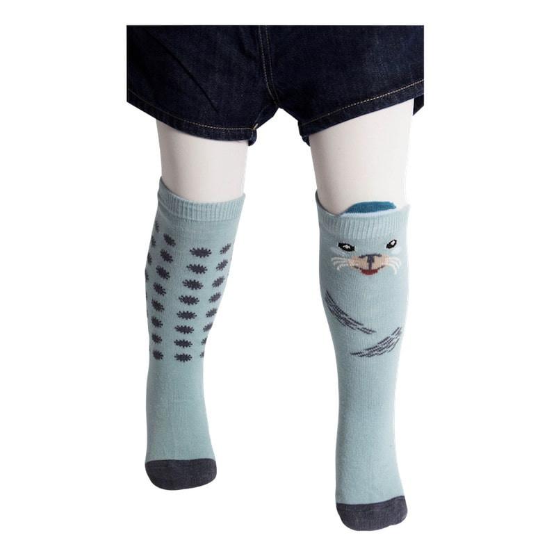paire de chaussettes hautes motifs phoque et flocons